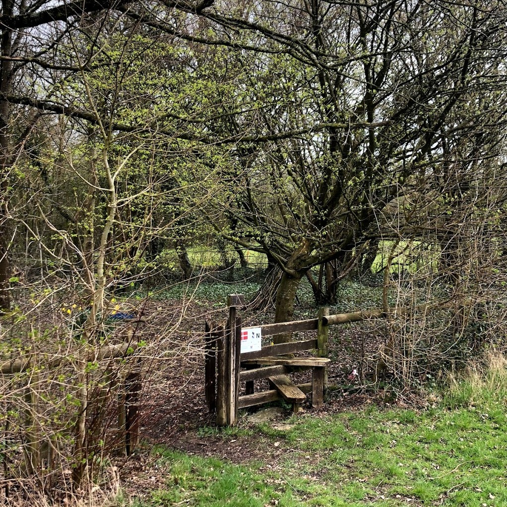 Gate and style leading to quiet area at Somermead, Outdoor Camping and Activity Venue